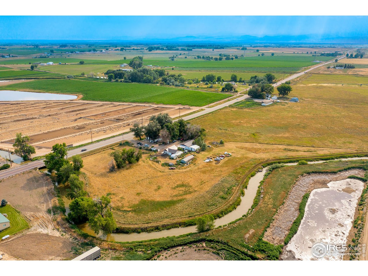 Aerial view looking south-west shows the property and the various outbuildings.