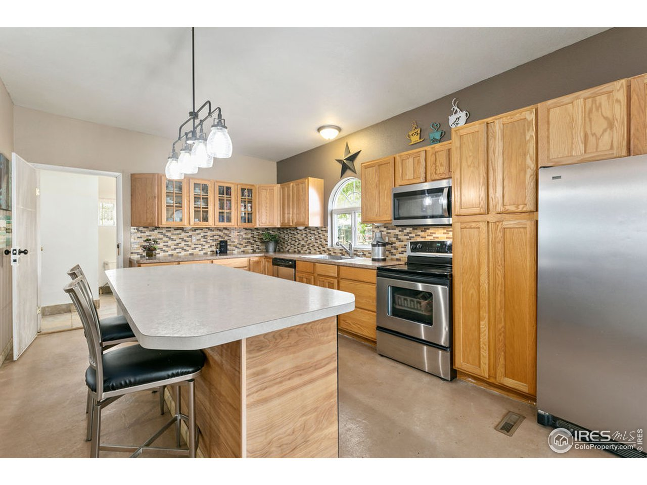 Lots of workspace and cabinet space greet you in the comfortable kitchen.