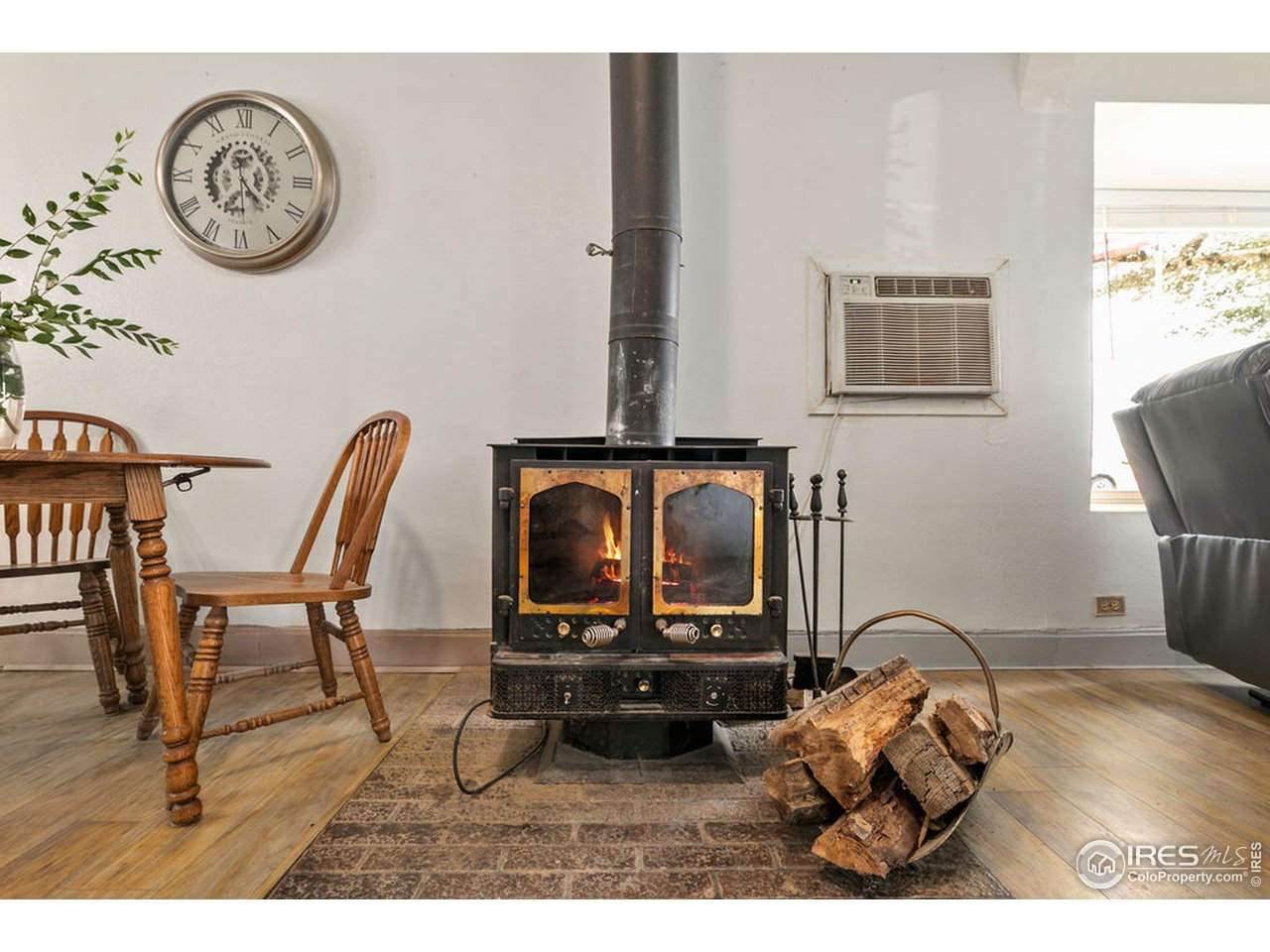 Cozy wood stove can heat the entire house, so furnace is rarely needed.