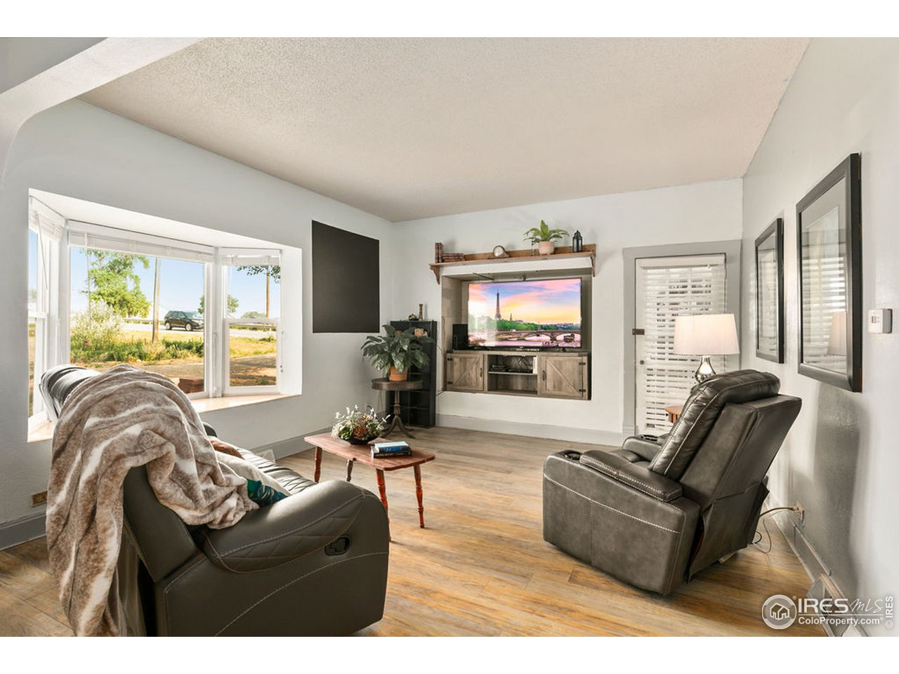 Bright, open, and inviting living room with newer paint and newer flooring.