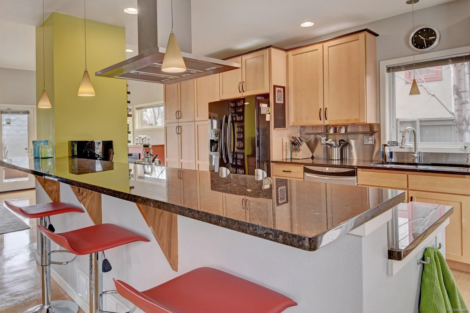 Sleek Modern Kitchen w/ SS Backsplash