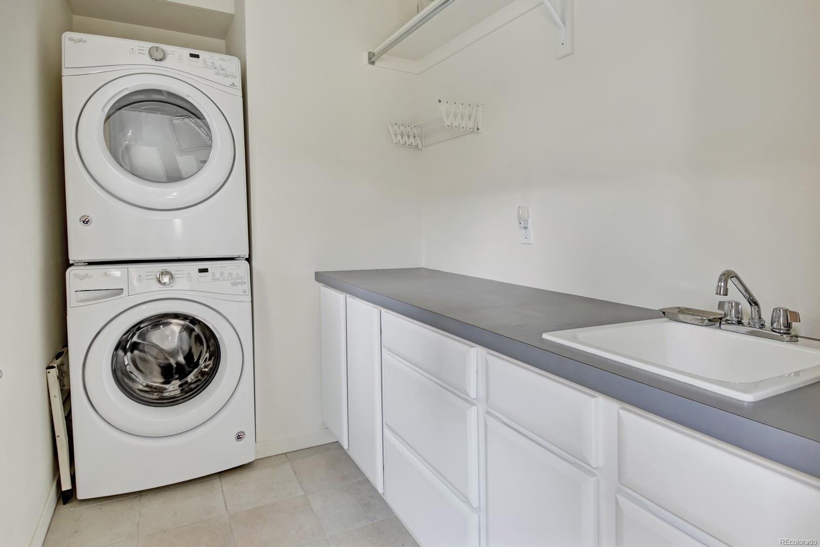 Nice sized Laundry Room w/ Sink.  W&D Included