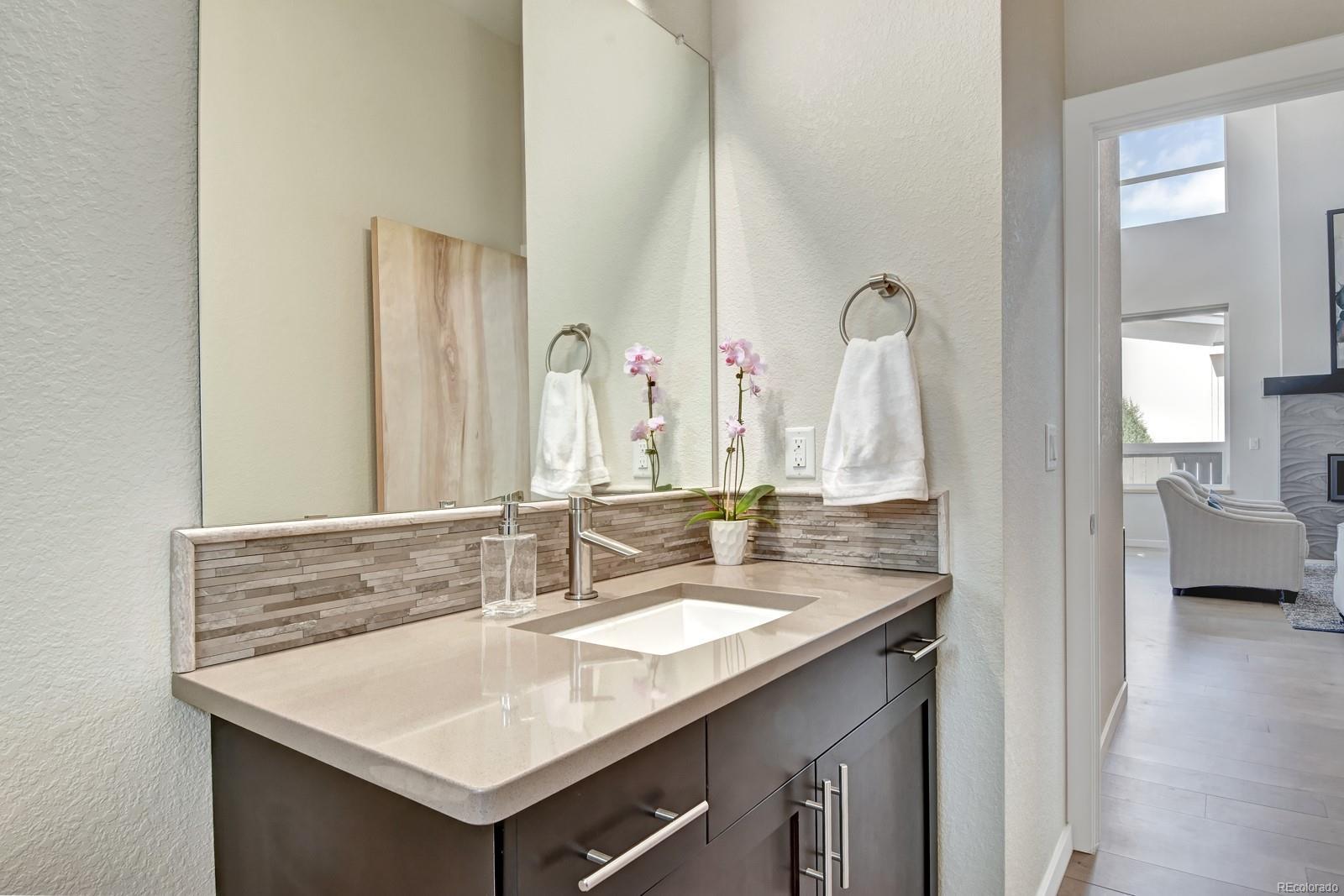 Powder Room w/ Quartz Counters & Designer Tile Finishes