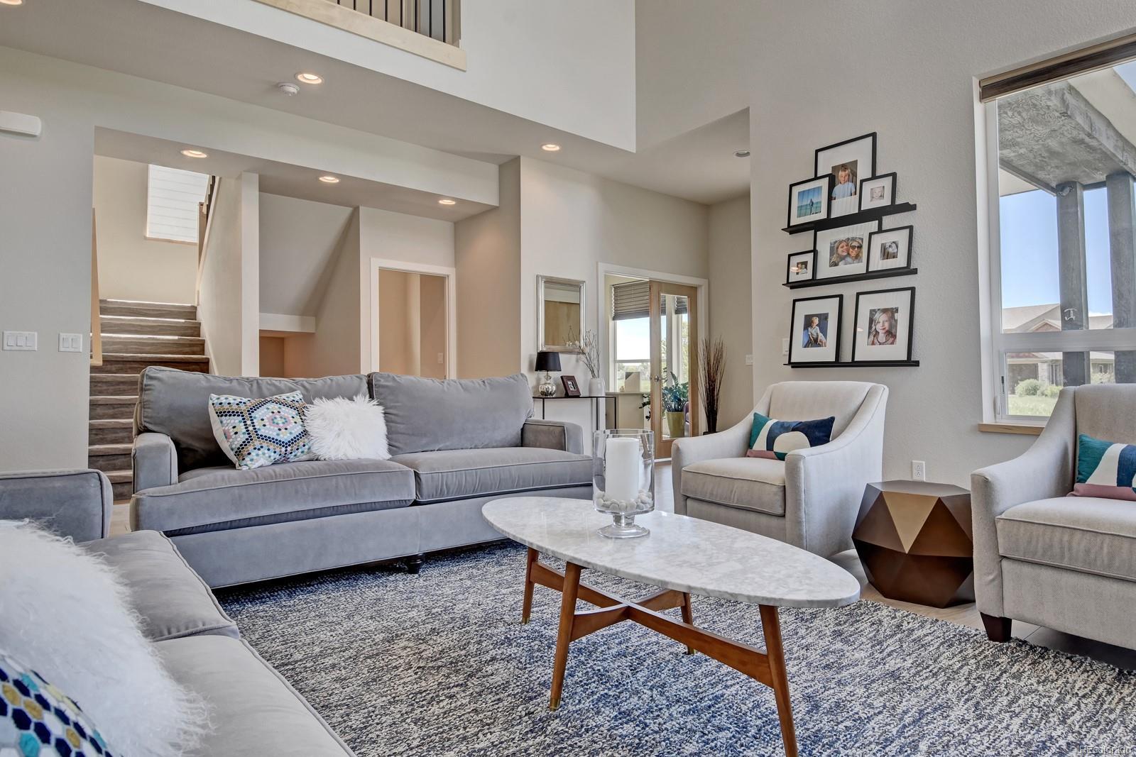 Living Room w/ Soaring 20' Ceilings