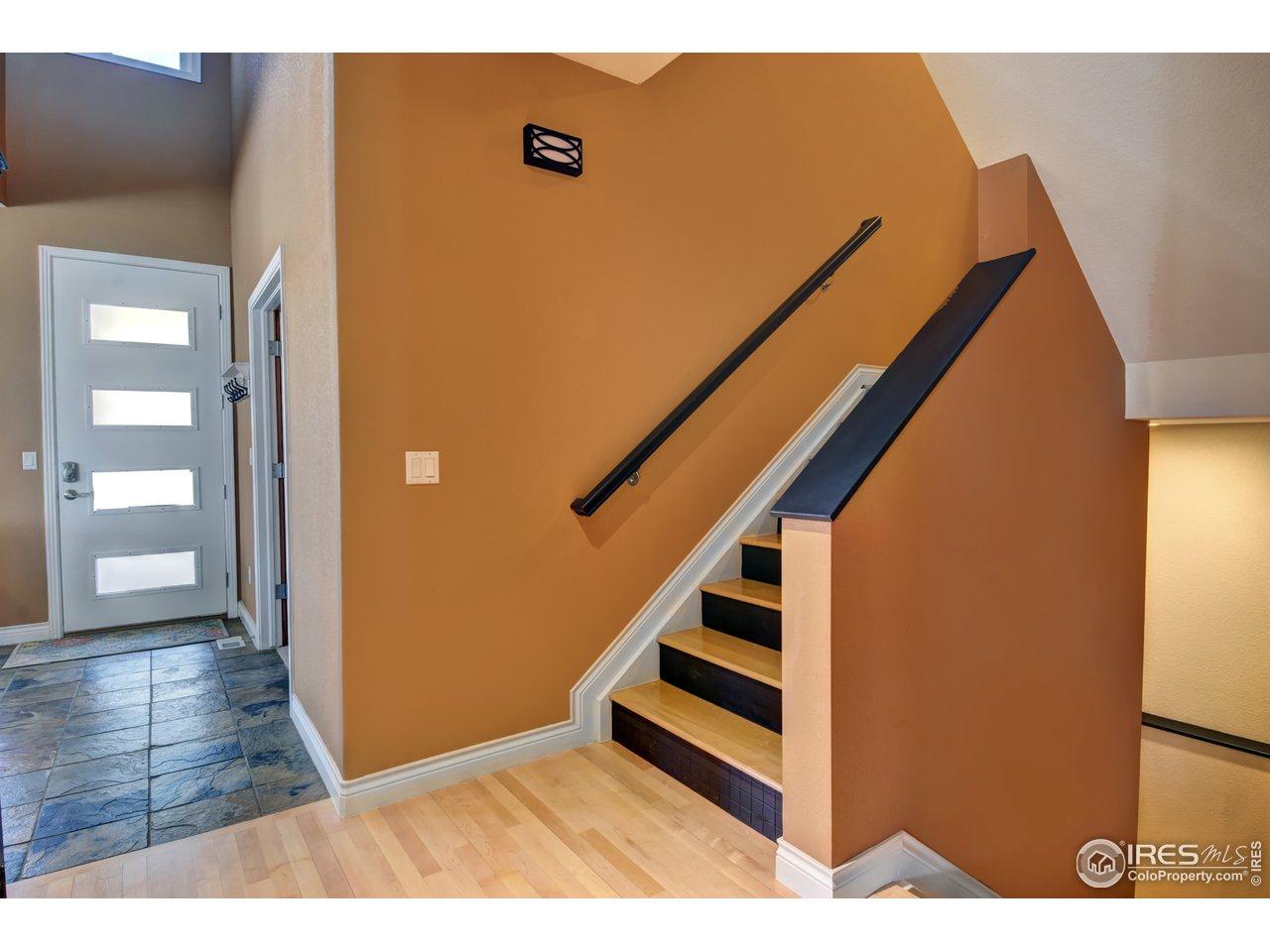 Slate Foyer, Maple Flooring w/ Tile Risers