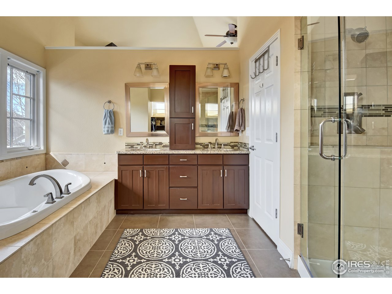 This master bath is gorgeous w/ custom tile & cabs