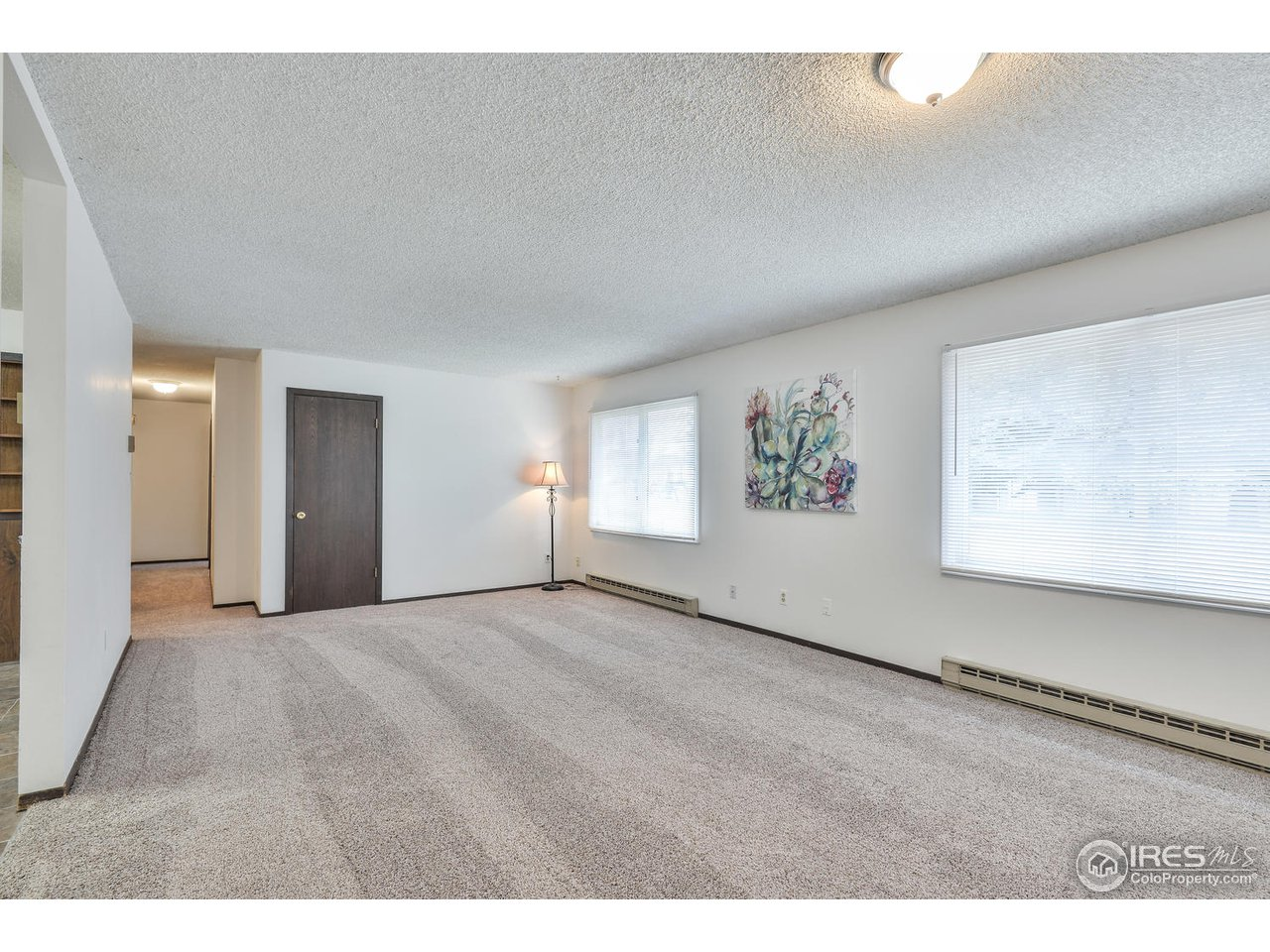 Great room facing bedroom hallway