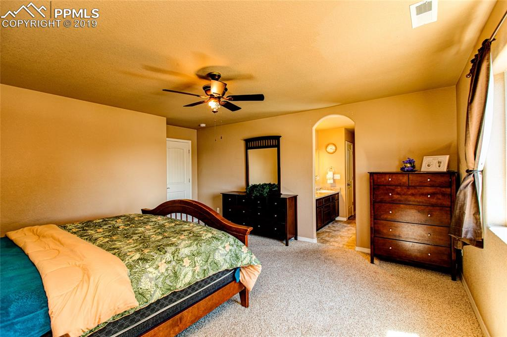 MASTER BEDROOM WITH ADJOINING 5 PIECE MASTER BATH AND WALK IN CLOSET.