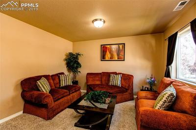 ENTER IN TO THE INVITING FAMILY ROOM.
