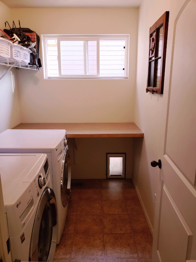 Laundry Room with dogie dog out to dog run