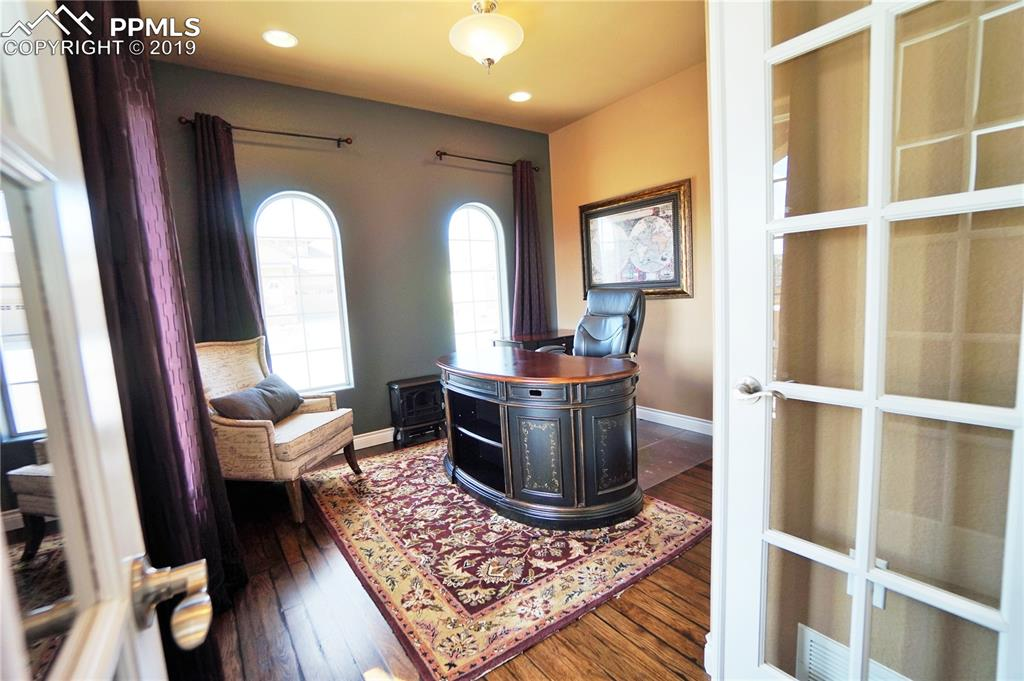 Main level office has beautiful arched windows and a separate closet.