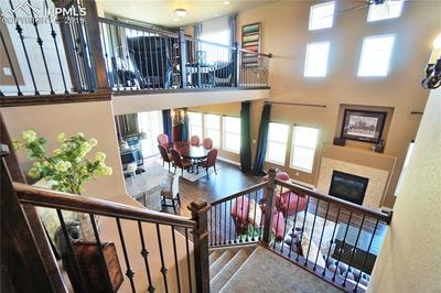 The upper floor has ridiculous views of the front range including Pike's Peak and is open to the living room below.