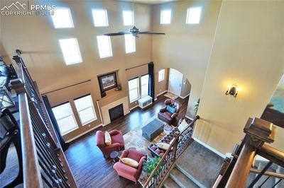 Towering ceilings in the living room let in tons of natural light through customized windows.