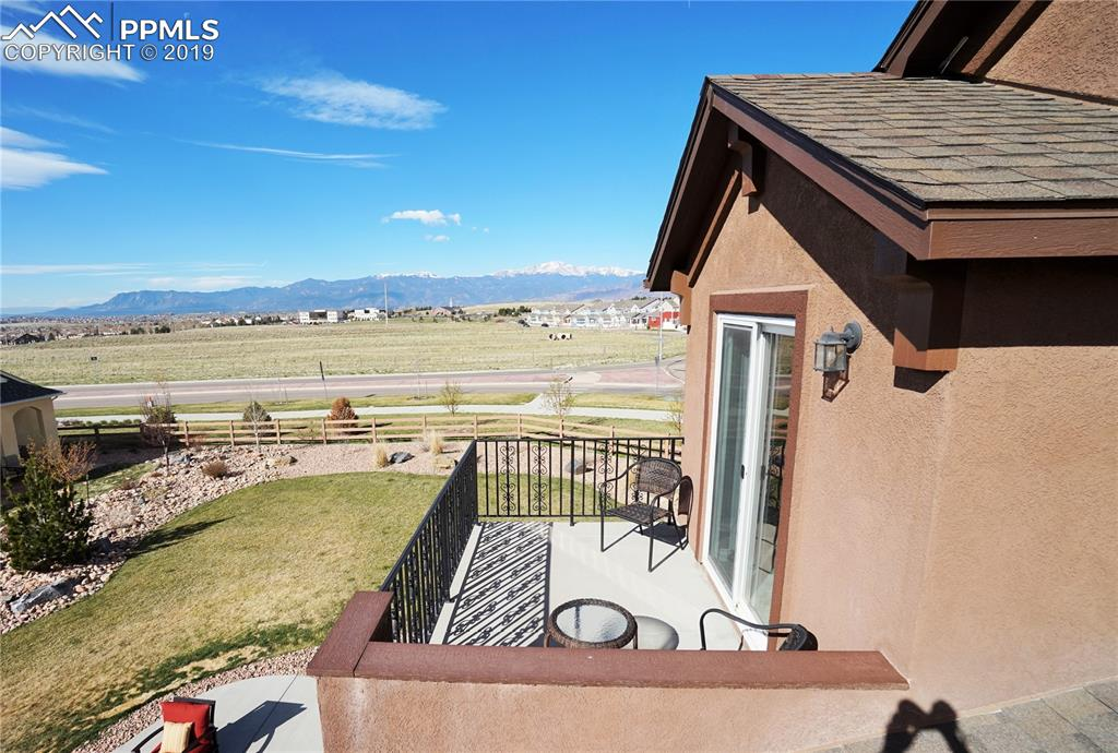 Roof garden looks over the rear yard and city and has panoramic mountain views including Pike's Peak.