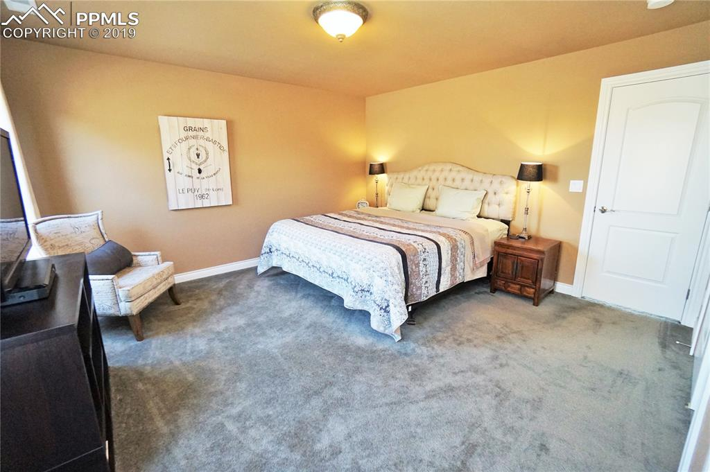 Very large upper bedroom has 2 windows and 2 closets.