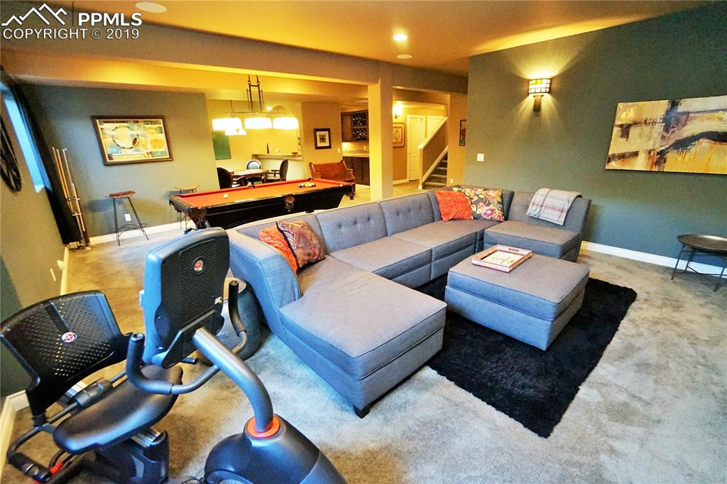 Fully finished basement has an open floor plan and tall ceilings.