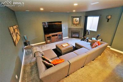 Media area includes built-in surround sound speakers and fireplace.