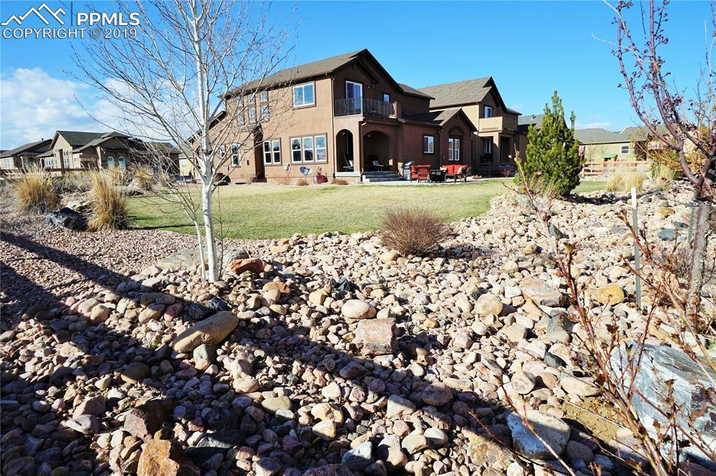 Home has rare panoramic views and lot size in Wolf Ranch.