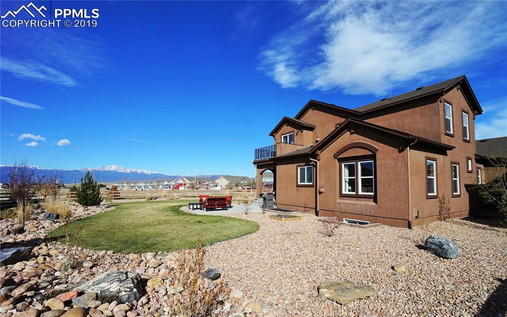 Great outdoor living with covered and extended patios and front and back sprinkler system.