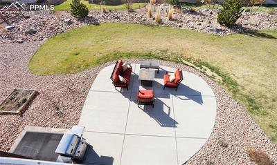Huge extended patio and gas line to grill and included fire-pit.