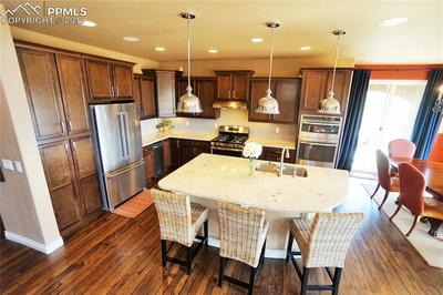 Kitchen also has: under and over cabinet lighting, staggered upper cabinets, vent hood, upgraded back-splash and pendant lighting.