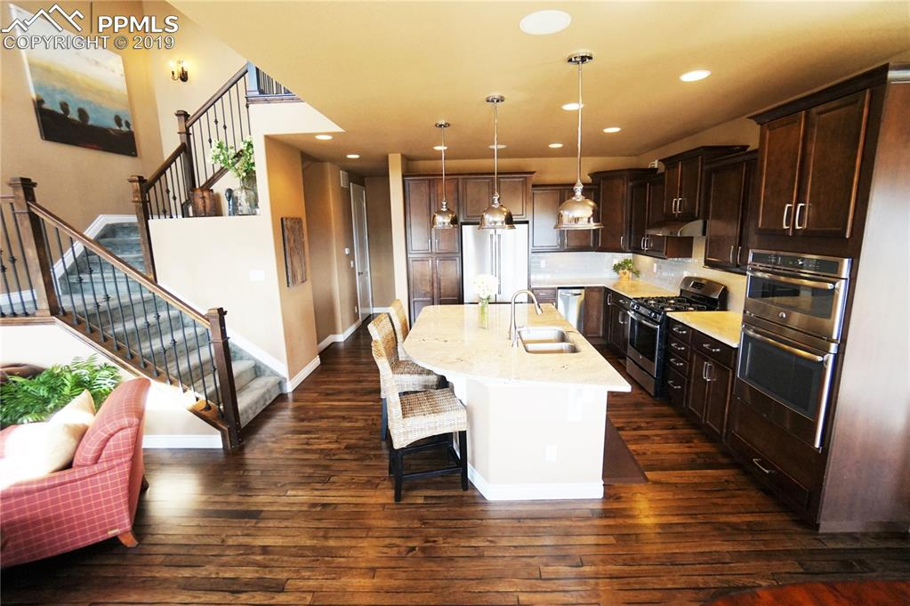Hickory hardwood floors extend the entire main level along with 8' doors.