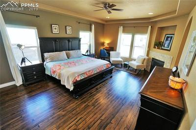 Main level master is huge and has a fireplace and coffered ceiling.