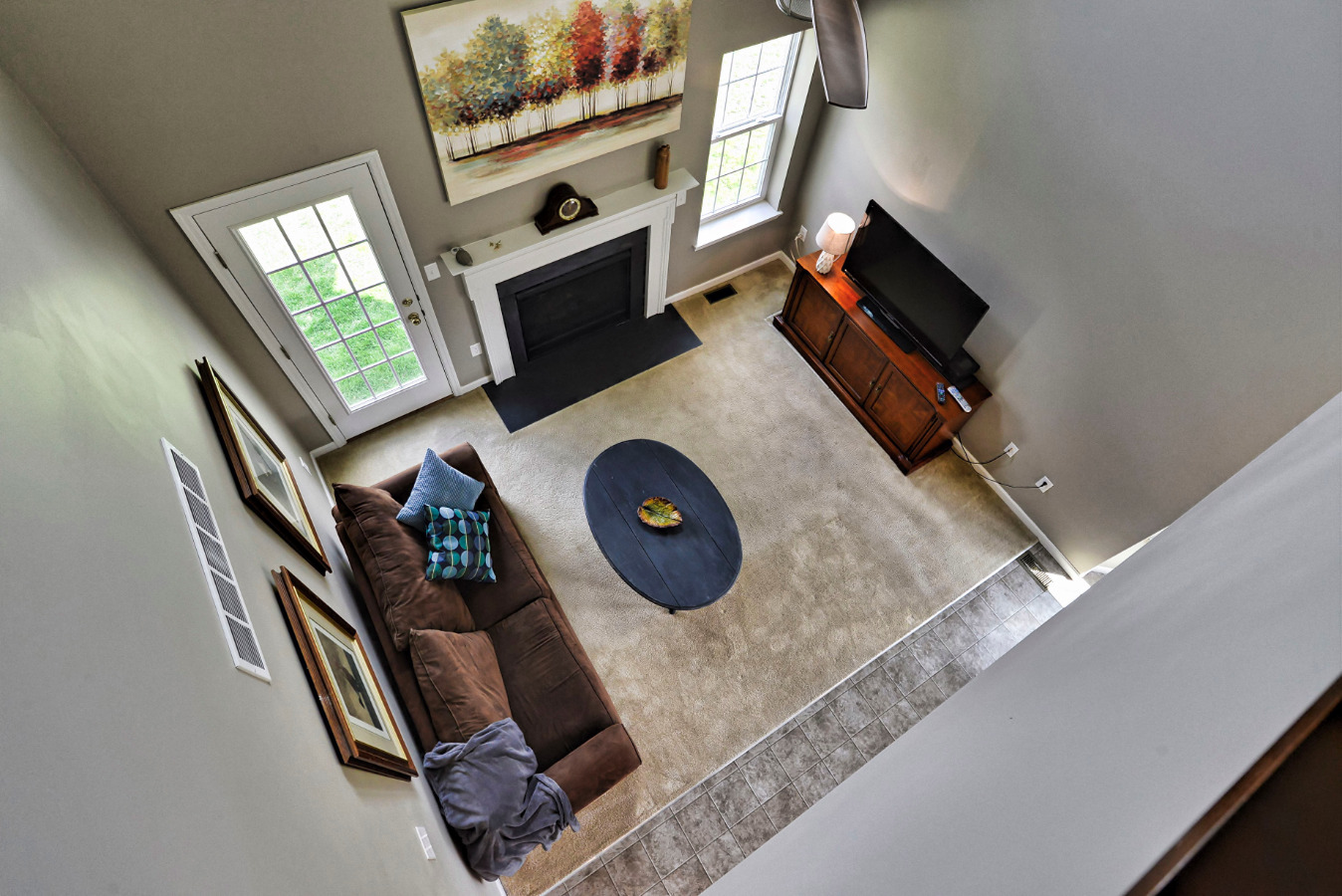 Lots of space below! Very high, dramatic living room ceilings lead to a feeling