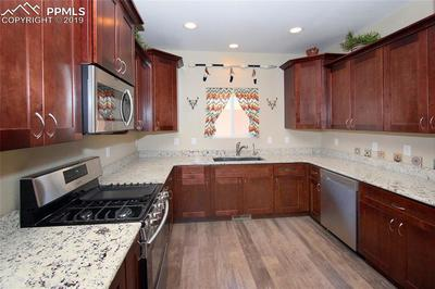 Plenty of storage in this well laid out kithcen!!! Granite counters with under mount sink