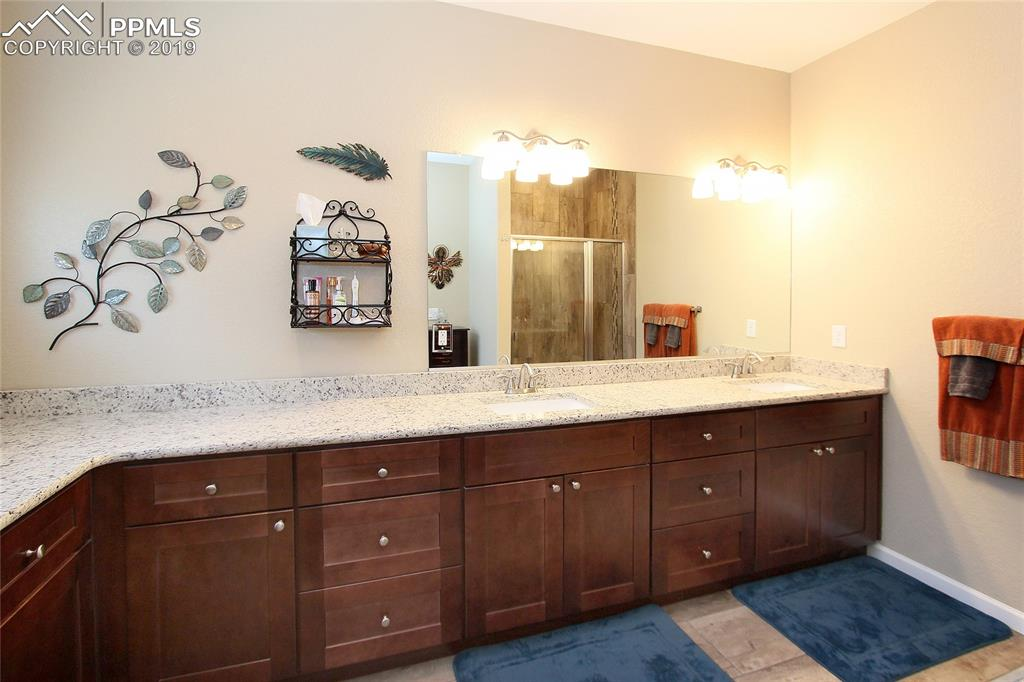 Custom master bath with plenty of storage and counterspace