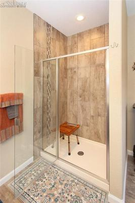 Large shower with beautiful accent tile