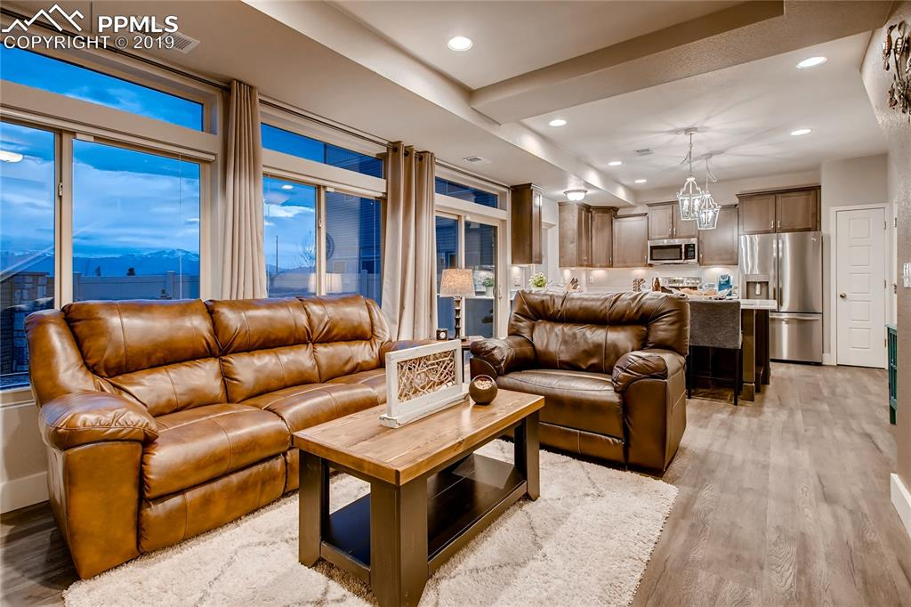 Main Level Living Room opens to large Kitchen, views of mountain range