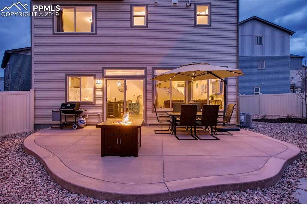 Spacious concrete patio in back for entertaining