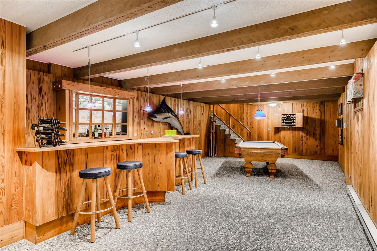 Basement Recreation Room and Bar paneled with Cypress wood.