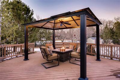 Gazebo with Firepit on back deck overlooking spacious backyard.