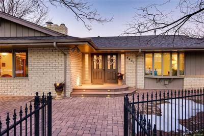 The home is surrounded by a brick patio and wrought iron fence...perfect for pet