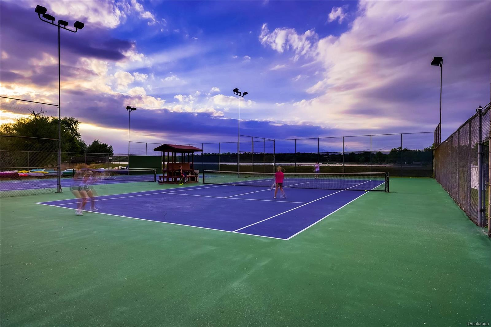 Two tennis courts overlooking Upper Tule Lake and Bow Mar Lake.
