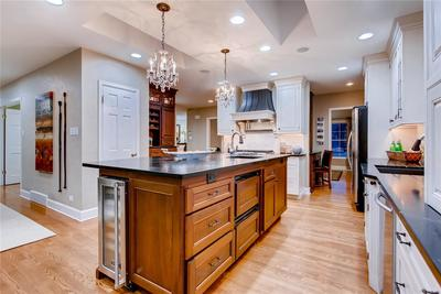 Custom wine cooler, built-in counter top steamer, beverage fridge and more.