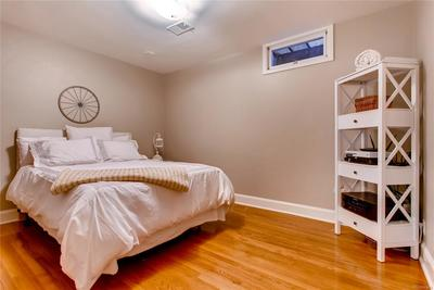 Basement Bedroom 4 (non-conforming) with hardwood floors throughout.