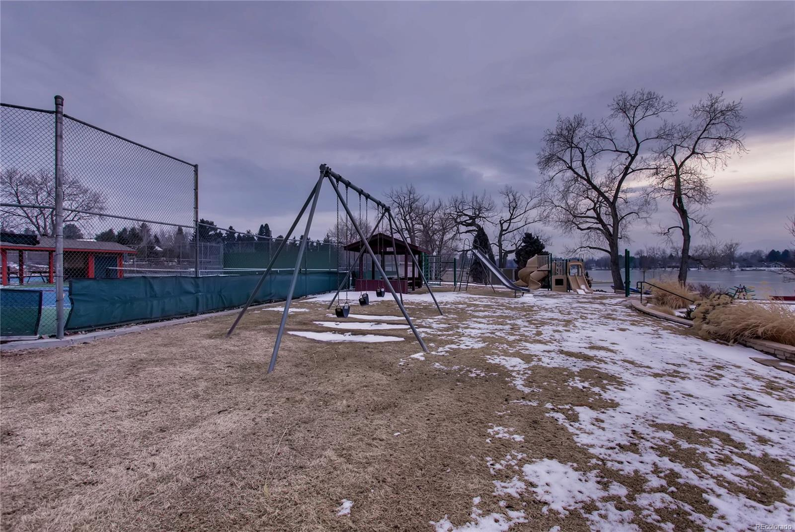 Playground area set between the tennis courts and the beach/lake.