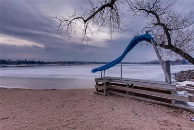 Part of the dock and slide, resting on the beach for the winter, will be back in