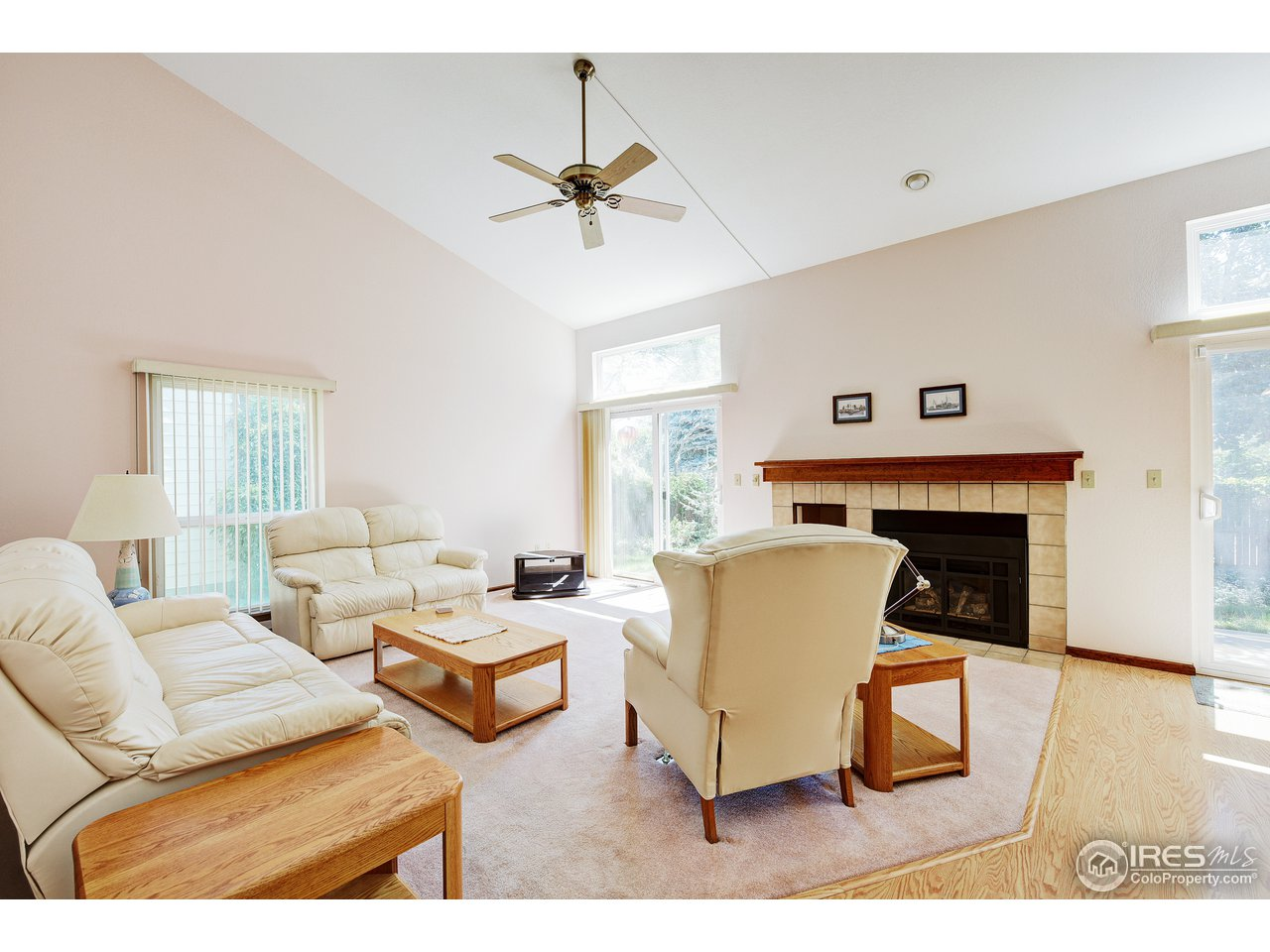 Living room opens onto backyard patio