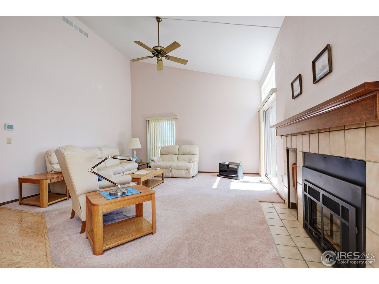 Living room with vaulted ceilings & gas fireplace