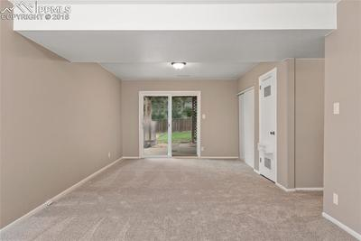 Basement family/rec room with walkout sliding door access to the back yard