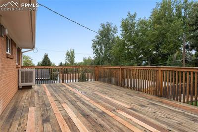 Party central! Large back deck offers room to entertain.