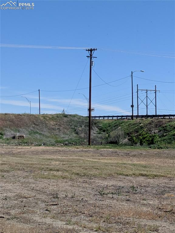 Looking Northeast from mid lot point out utility poles on the property line