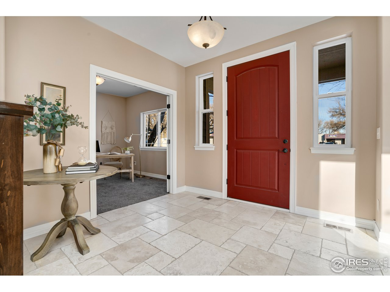 Front door and foyer looking into conforming bedroom or study with french doors
