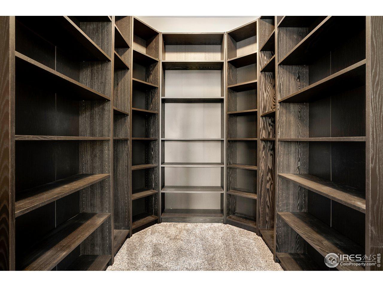 Custom shelving included in den/office closet