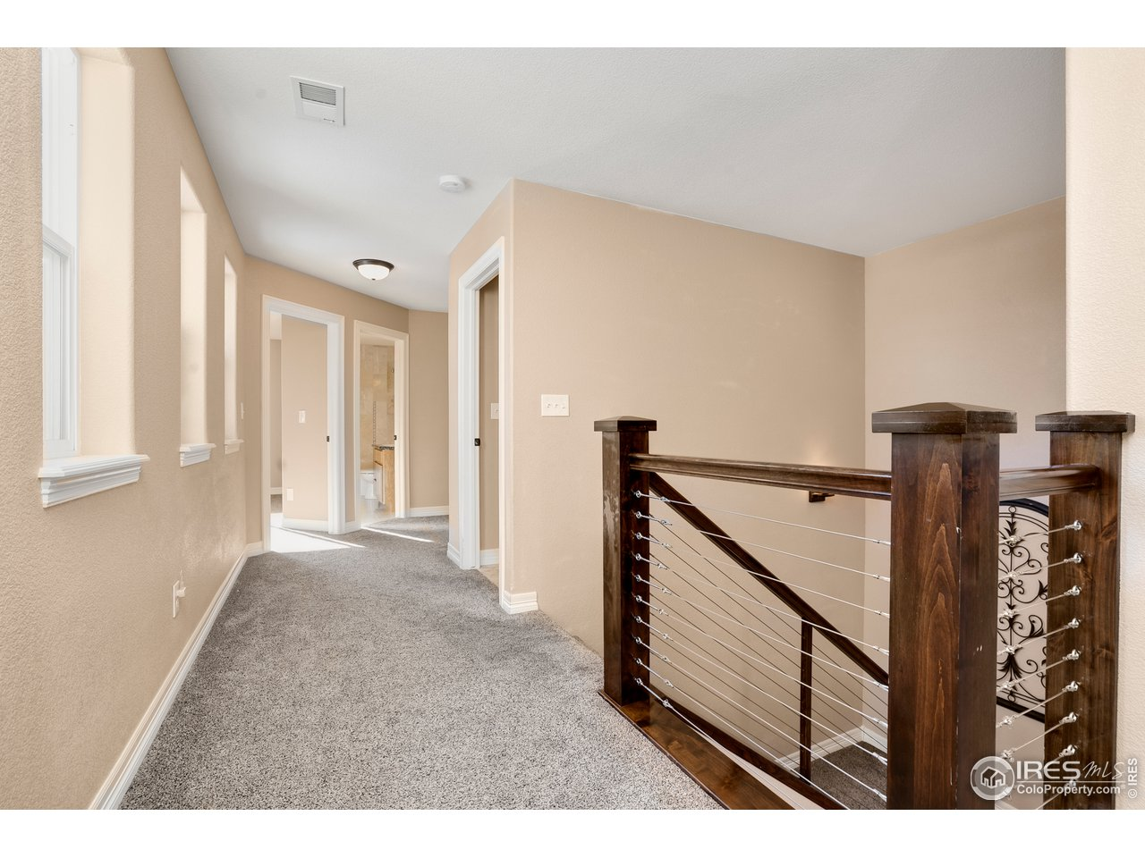 upstairs landing/hallway with is light and bright