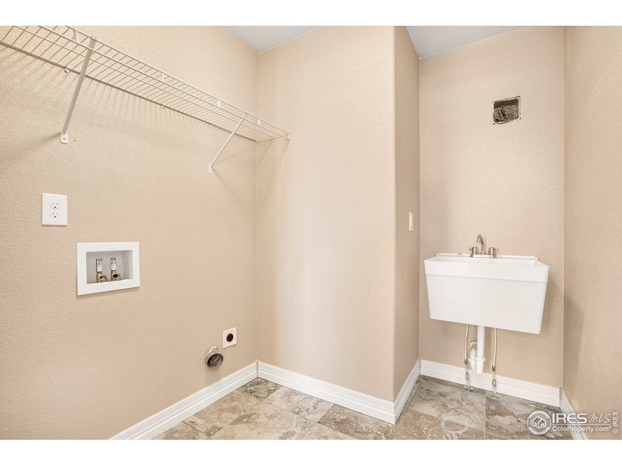 Laundry room with wash tub on 2nd level